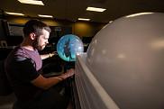 Adaptation de la technologie tactile développée au GAUS sur un écran sphérique
