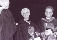 <p>Remise d&rsquo;un doctorat honorifique &agrave; Anne H&eacute;bert le 12 juin 1993. Mgr Jean-Marie Fortier, chancelier de l'Universit&eacute;, Anne H&eacute;bert et Normand Wener, doyen de la Facult&eacute; des lettres et sciences humaines (FLSH)</p>