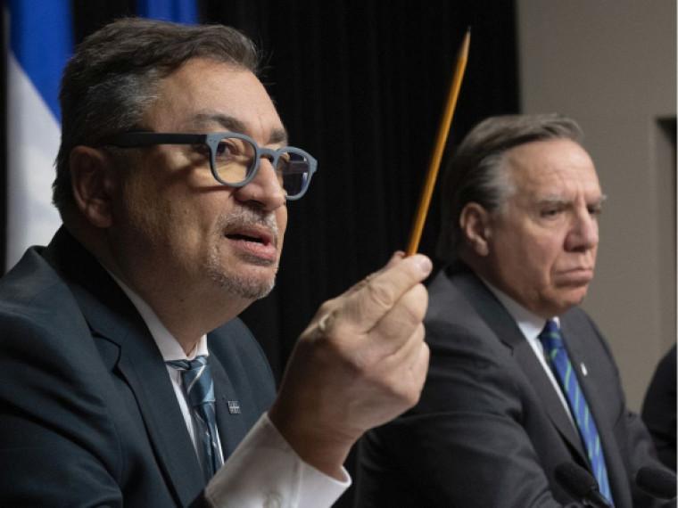 Horacio Arruda et le premier ministre François Legault lors du point de presse quotidien.