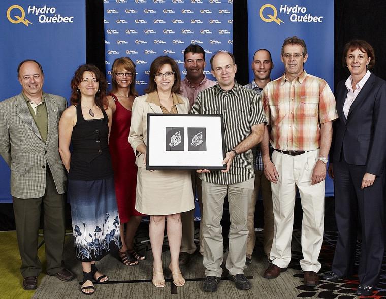 La reconnaissance constitue l'aboutissement d'un travail d'équipe, selon René Alarie, à gauche sur la photo.