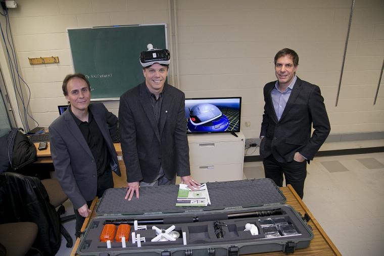 Yan Cyr, fondateur de la Fabrique d'Holodeck, Patrik Doucet, doyen de la Faculté de génie, et Charles Bombardier, président d'Imaginactive
