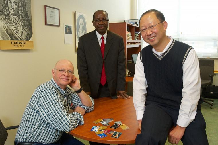 Les professeurs André Mayers, Ernest Monga et Shengrui Wang